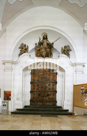 Germany, Upper Bavaria (South), Ebersberg, Sebastianskirche (1472-1504), Gothic doorway decorated above with gilded - Stock Photo