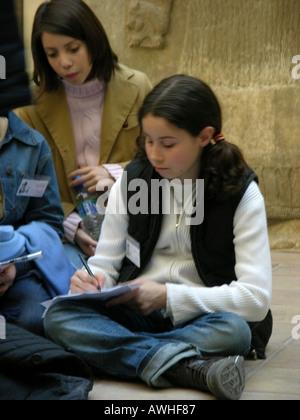 France Paris children studying art in Louvre Museum - Stock Photo