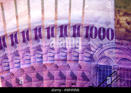 A fan of 8000 Swiss francs in high-denomination 1000 franc notes - Stock Photo
