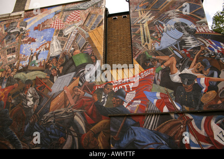 A wall mural in Cable Street London marking the battle between The British Union of Fascists led by Oswald Mosley - Stock Photo