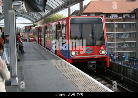 DLR train entering Shadwell station London - Stock Photo
