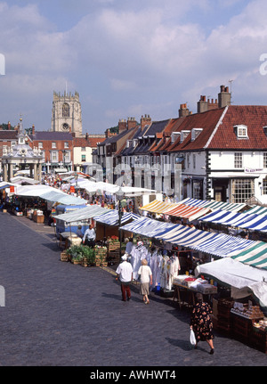 Beverley looking down on market place with stalls & canopies market cross & St Marys church tower beyond - Stock Photo
