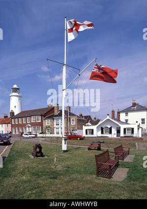 Southwold seafront Flag Station with Lighthouse beyond includes seating and small cannons - Stock Photo