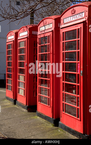 Row of 4 red phone British boxes in Truro, Cornwall UK. - Stock Photo