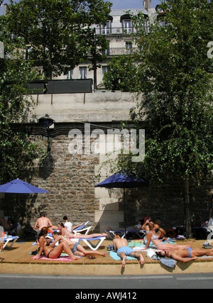 France Paris Paris-Plage sunbathers relaxing on beach - Stock Photo