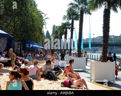 france paris paris-plage people relaxing on artificial beach along the banks of the Seine river - Stock Photo