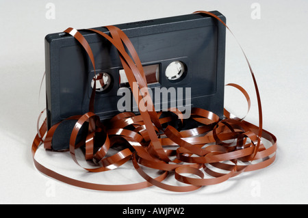 Audio cassette with tape spilling out - Stock Photo