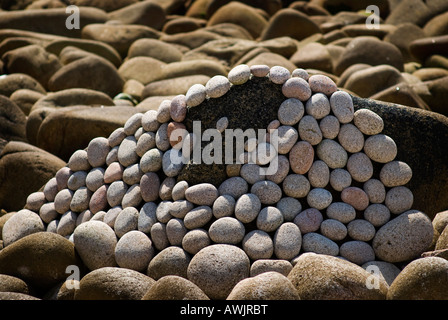 Cairns on a rocky shore, Isles of Scilly - Stock Photo
