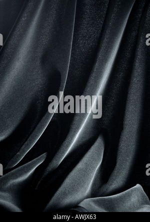 Folds in shiny black fabric, close-up, full frame - Stock Photo
