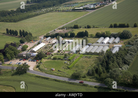 High level oblique aerial view south east of Patch Park Nurseries Epping Forest Romford London RM4 England UK - Stock Photo