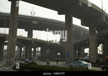 Concrete road flyover in Shanghai China urban concrete jungle vehicle transport transportation network system planning - Stock Photo
