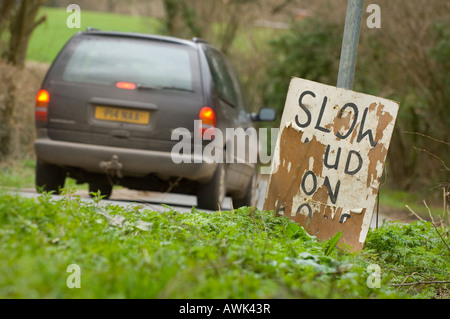 Mud on road sign beside a country lane warning motorists of danger. Picture by Jim Holden. - Stock Photo