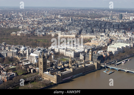 High level oblique aerial view north west of Houses of Parliament Big Ben Westminster Abbey River Thames - Stock Photo