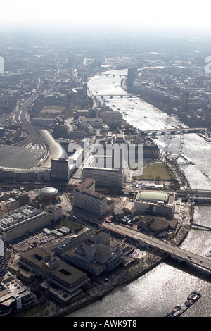 High level oblique aerial view south of Waterloo International Station London Eye River Thames London Aquarium - Stock Photo