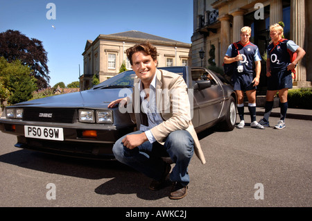 STEPHEN BOWMAN OF THE CLASSICAL POP GROUP BLAKE WITH HIS DE LOREAN CAR AUG 2007 WATCHED BY ENGLAND RUGBY PLAYERS - Stock Photo