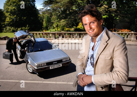 STEPHEN BOWMAN OF THE CLASSICAL POP GROUP BLAKE WITH HIS DE LOREAN CAR BEING UNLOADED BYA DOORMAN AT THE BATH SPA - Stock Photo