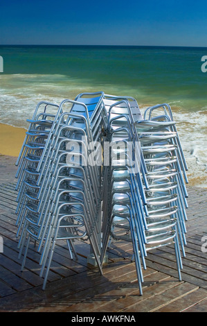CHAIRS PILED. PILES OF CHAIR IN BEACH TERRACE - Stock Photo