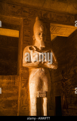 Statue inside the mortuary temple of Ramses II dedicated to Re Herakhte in the interior of Abu Simbel Great Temple - Stock Photo