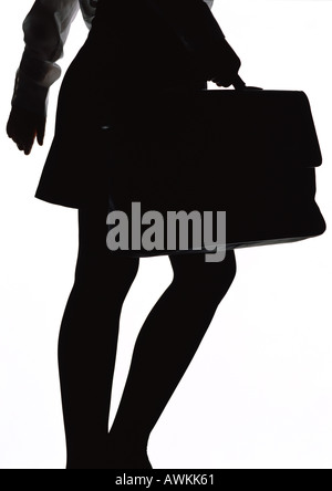 Woman walking with briefcase, silhouette. - Stock Photo