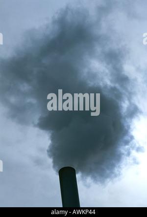 Smoke from a smoke stack, low angle view - Stock Photo