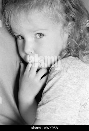 Girl with fingers in mouth, portrait, b&w - Stock Photo