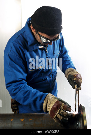 Man using welding torch - Stock Photo