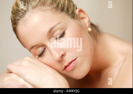 Young blonde woman resting - Stock Photo