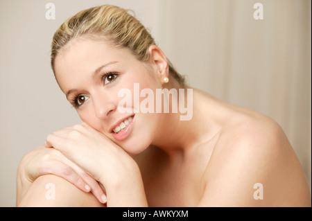 Smiling young blonde woman - Stock Photo