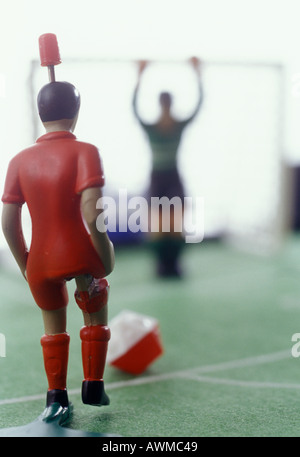 Close-up of figurine of soccer player - Stock Photo
