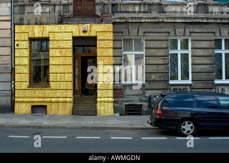 Partly-restored facade on a damaged building - Stock Photo