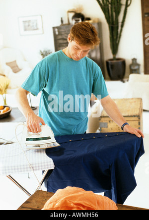 Man ironing clothes - Stock Photo