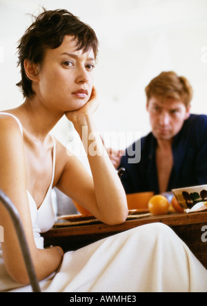 Couple having breakfast in silence, woman turning away from man - Stock Photo