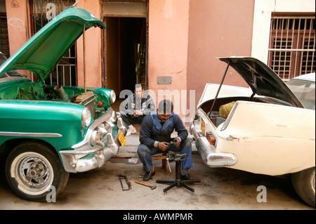 Repairing American vintage cars, Havana, Cuba, Caribbean - Stock Photo