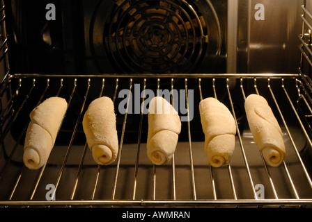 Depp-frozen crude dough in an oven - Stock Photo