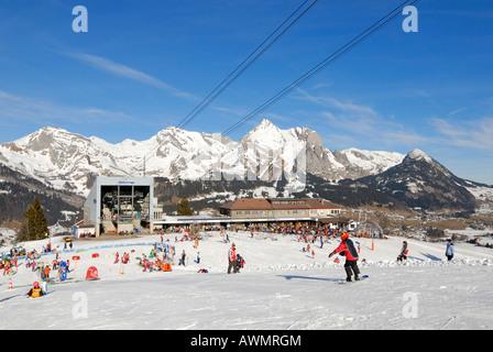 Restaurant on the Iltios mountain and the aerial railway station - Unterwasser, Canton of St. Gallen, Switzerland, - Stock Photo