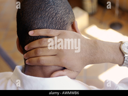 Man, hand on back of neck, rear view, close-up - Stock Photo