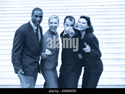 Business people posing, black and white, cool toned. - Stock Photo