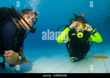 Girl taking scuba lessons in a swimming pool, Indonesia, Asia - Stock Photo