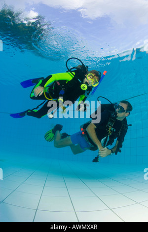 A girl is doing a diving training in the swimming-pool, Indonesia. - Stock Photo