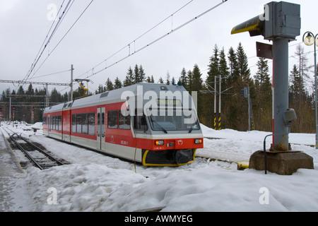 Tatra Electric Railway in the snow, Strbske Pleso, Slovakia, Europe - Stock Photo