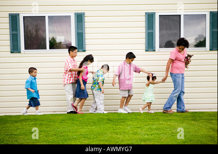 Children walking next to house - Stock Photo