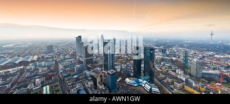 Panorama shot, skyline featuring the Sparkasse- and Convention Towers and central rail station, sunset augmented - Stock Photo