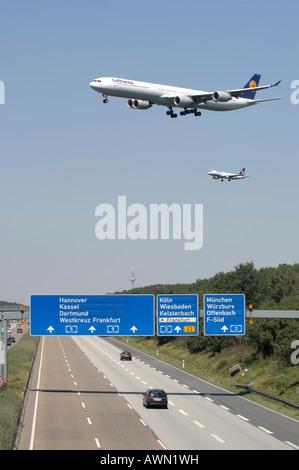 Two Lufthansa jets approaching Frankfurt International Airport for landing in Frankfurt, Hesse, Germany, Europe - Stock Photo