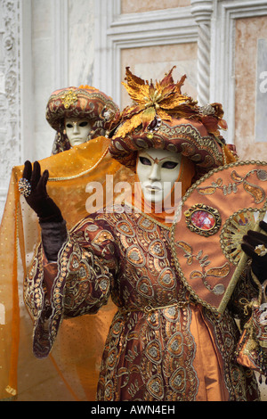 Person wearing a costume and mask during Carnival in Venice, Italy, Europe - Stock Photo