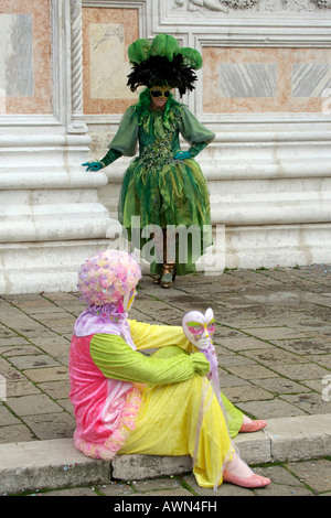 Person dressed in a costume and mask during Carnival in Venice, Italy, Europe - Stock Photo
