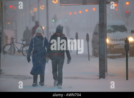Walking in Snow Storm Reykjavik Iceland - Stock Photo