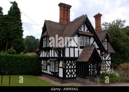 Old English Tudorbethan house with two chimneys, part of Ragley Hall, Alcester, Warwickshire, West Midlands, England, - Stock Photo