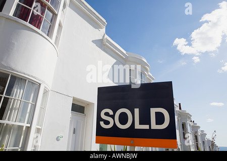 Sold sign outside house - Stock Photo
