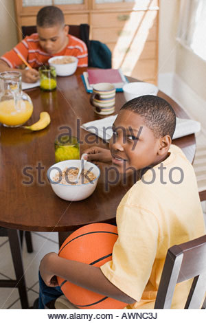 Boys having breakfast - Stock Photo
