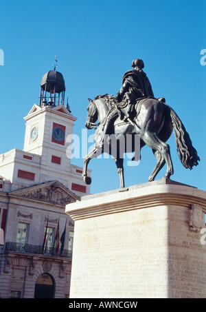 Equestrian statue of king Carlos III and clock tower. Puerta del Sol. Madrid. Spain. - Stock Photo